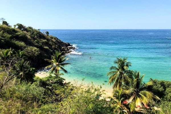The beautiful Playa Carrizalillo. One of the most unique places to visit in Mexico is Puerto Escondido, Oaxaca!