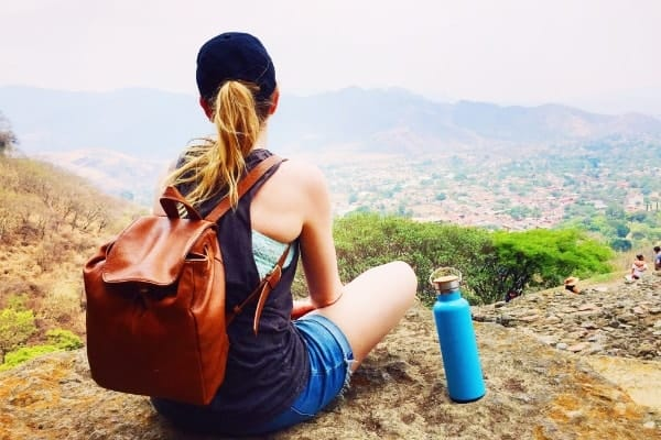 On of the best sustainable travel tips is to always carry a reusable water bottle.