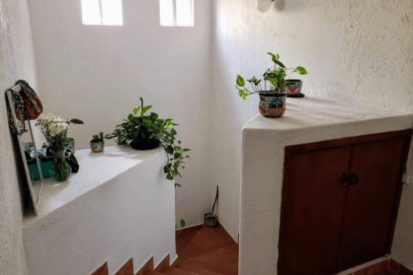 Stairs in a white adobe house for rent in Mexico.