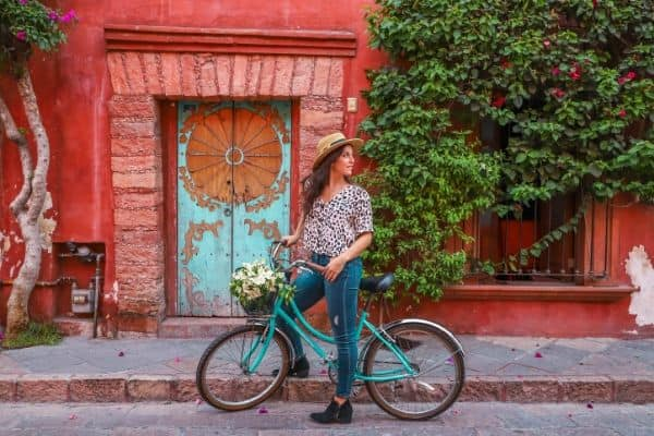 Travel blogger riding a bike in Mexico. Who is Backpacking Brunette? I'm Alex, the brunette backpacker behind this blog.